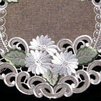 embroidered white daisy on brown doilies