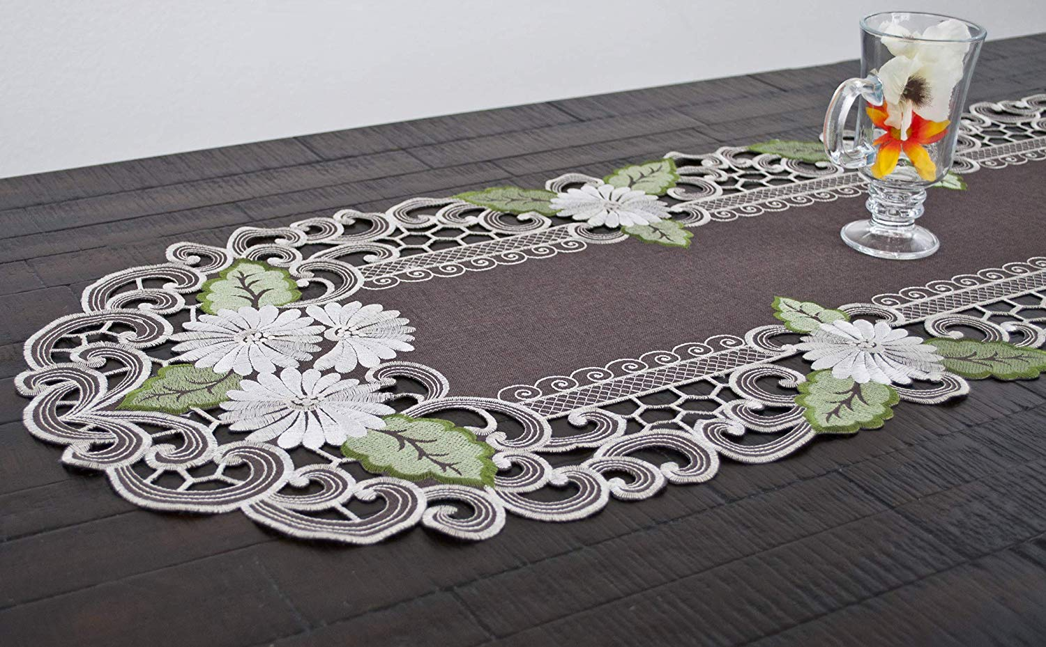 embroidered daisy on brown table runner